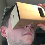 josh holding a google cardboard up to his eyes