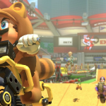 mario in tanooki suit on a motorcycle