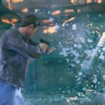 actor shawn ashmore portrays jack joyce using a time shield and pointing a gun at a bad guy in quantum break